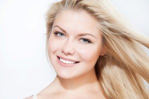 Blonde model smiling | North Vancouver Acne Treatment | Afterglow Skin Care Clinic