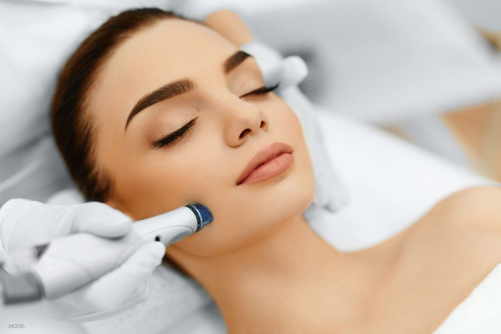 A woman undergoes microneedling