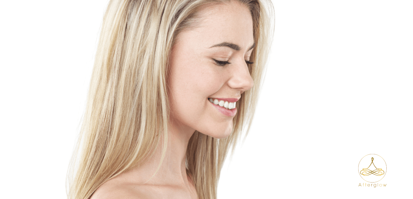Happy Blond Woman Smiling | Afterglow Skin Care Clinic